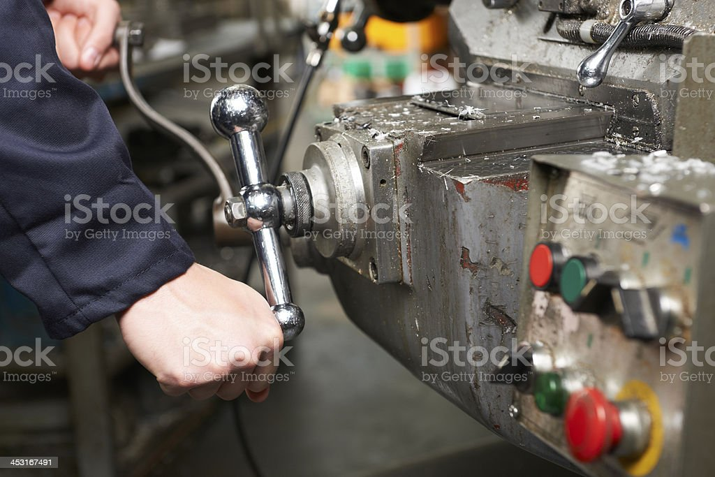Detail Of Engineers Hands Operation Controls On Lathe royalty-free stock photo