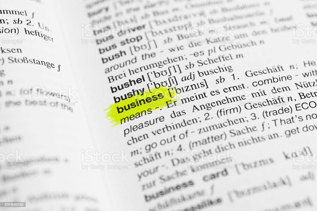 Detail of english word 'business' and its german translation stock photo