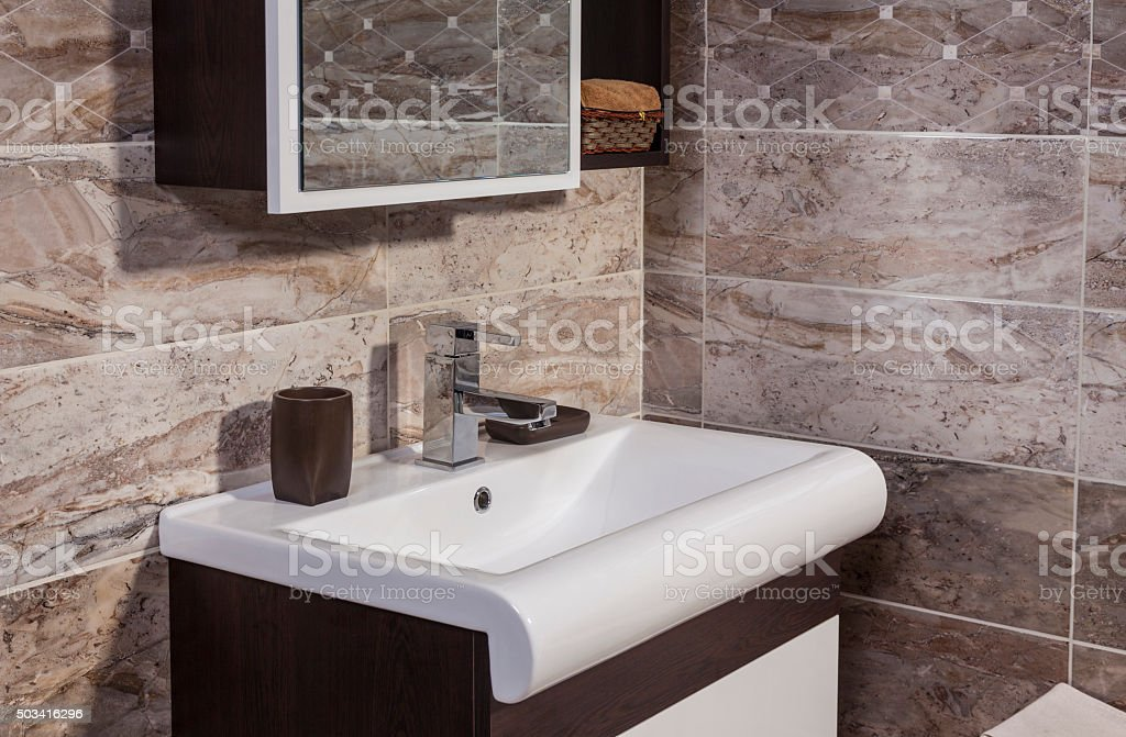 detail of fashionable bathroom – sink and  mirror stock photo