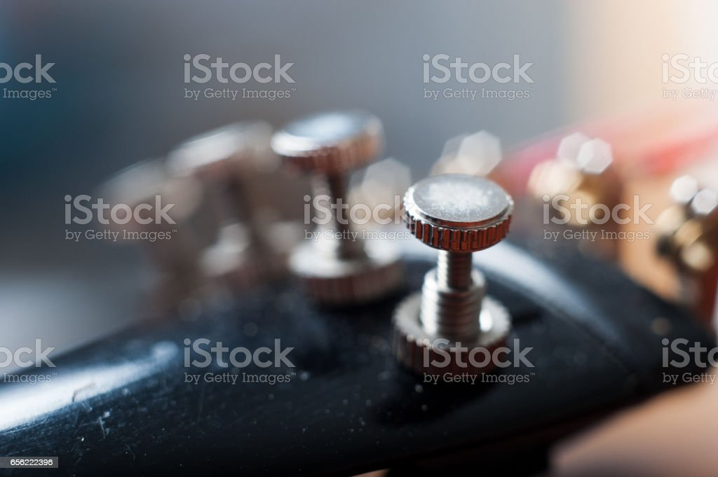 Detail of fine tuners on an antique violin stock photo