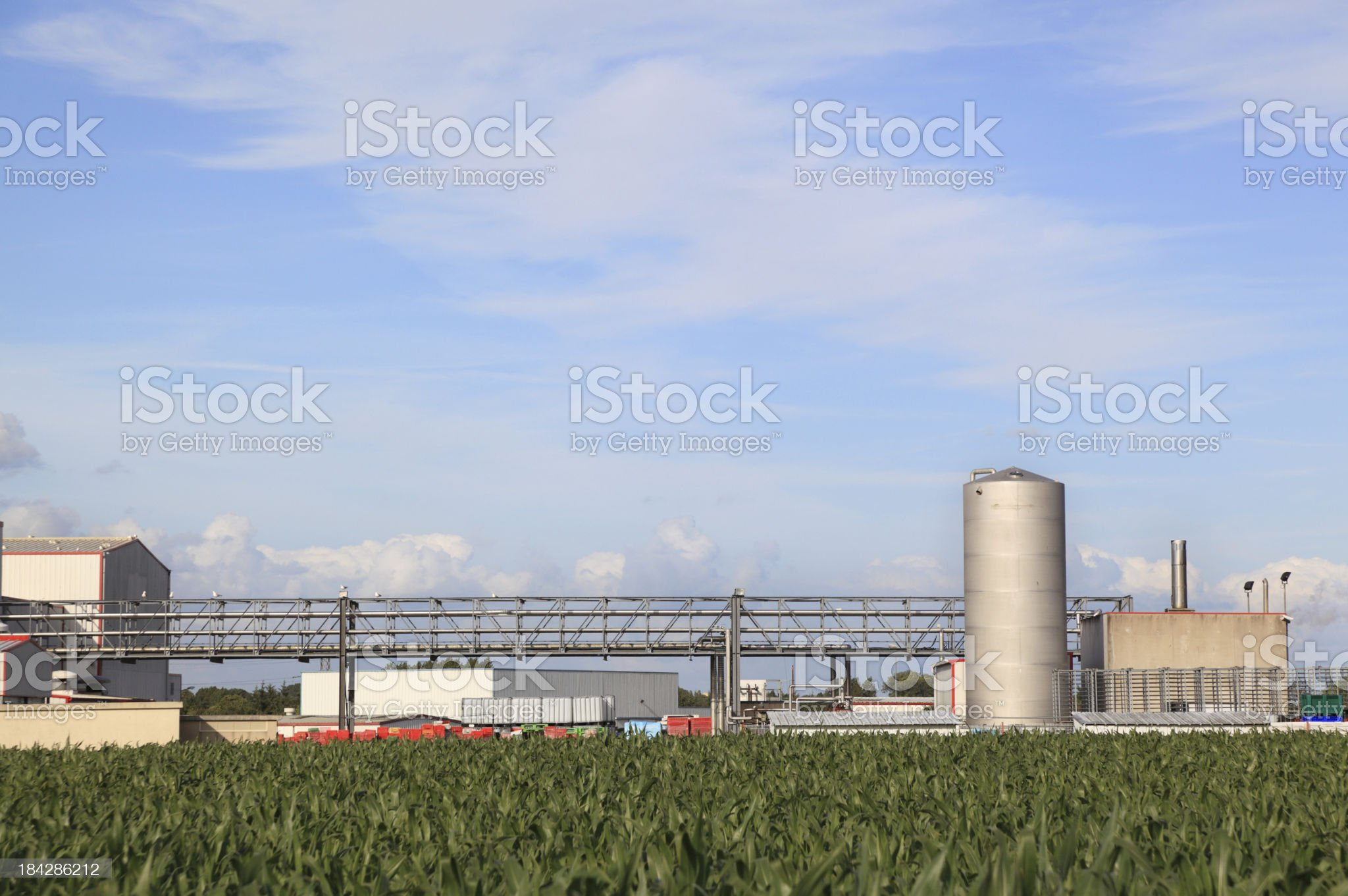 detail of food processing plant in summer countryside blue sky royalty-free stock photo