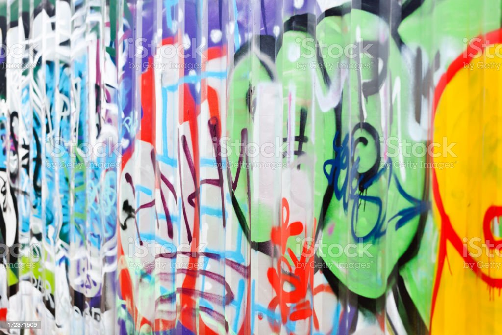 Detail of graffiti on container. Art or vandalism. shallow dof. royalty-free stock photo