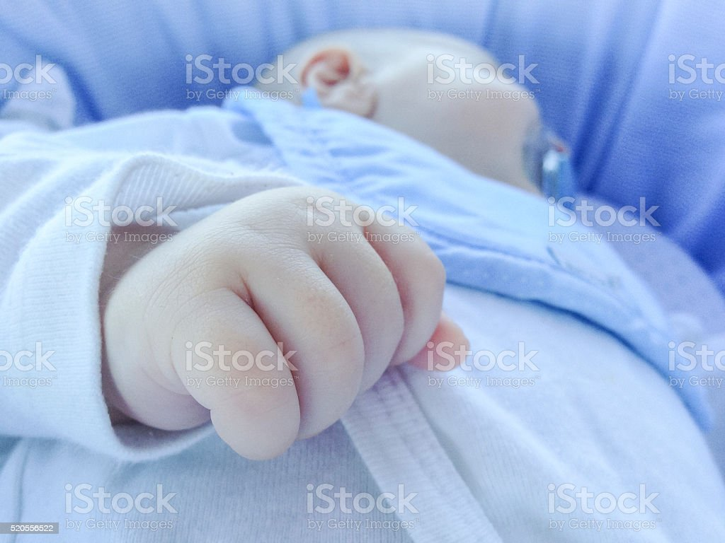 Detail of hand at sleeping four month baby boy stock photo
