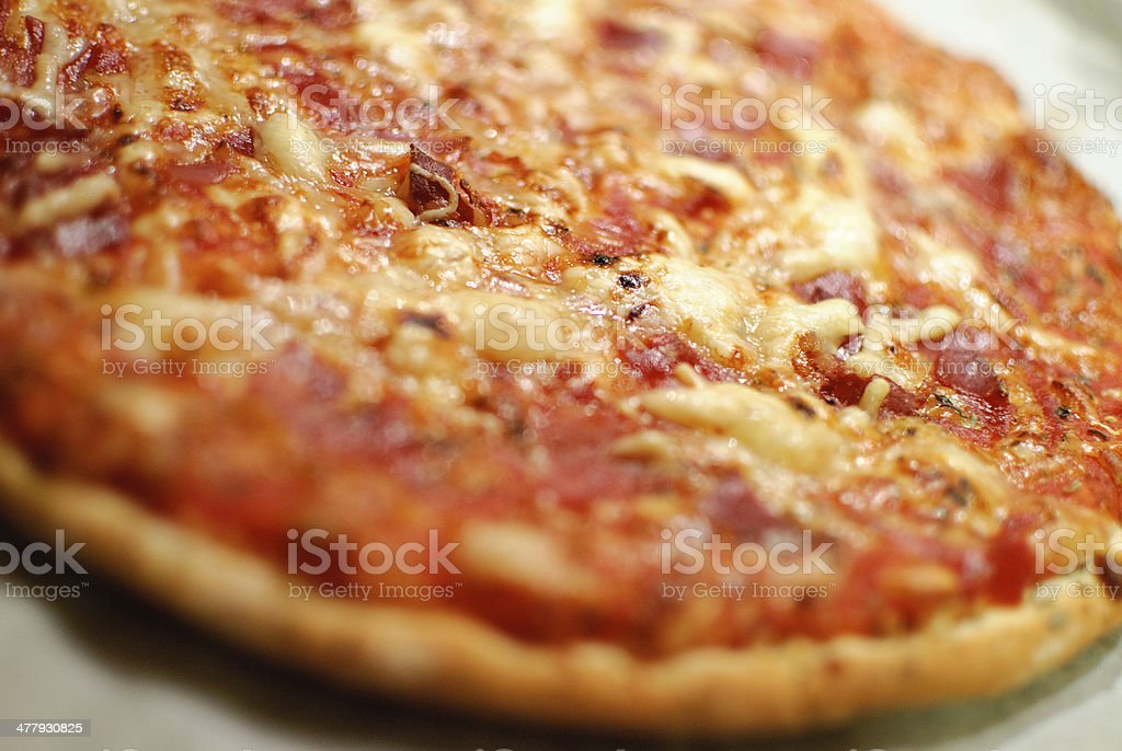 Detail of homemade pizza, selective focus (shallow depth of field) stock photo