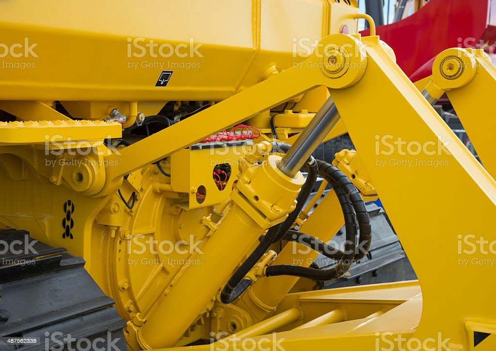 Detail of hydraulic bulldozer piston stock photo