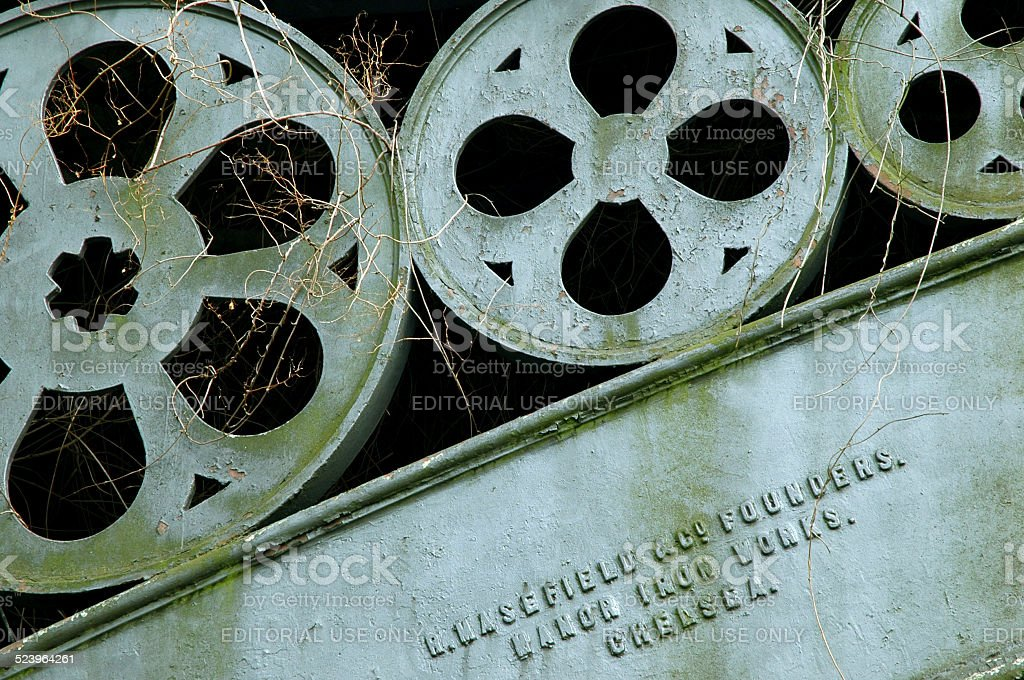 Detail of iron arch supporting bridge over canal in London stock photo