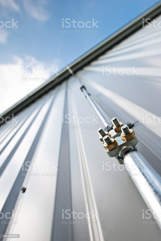 Detail of lightning conductor on the wall stock photo