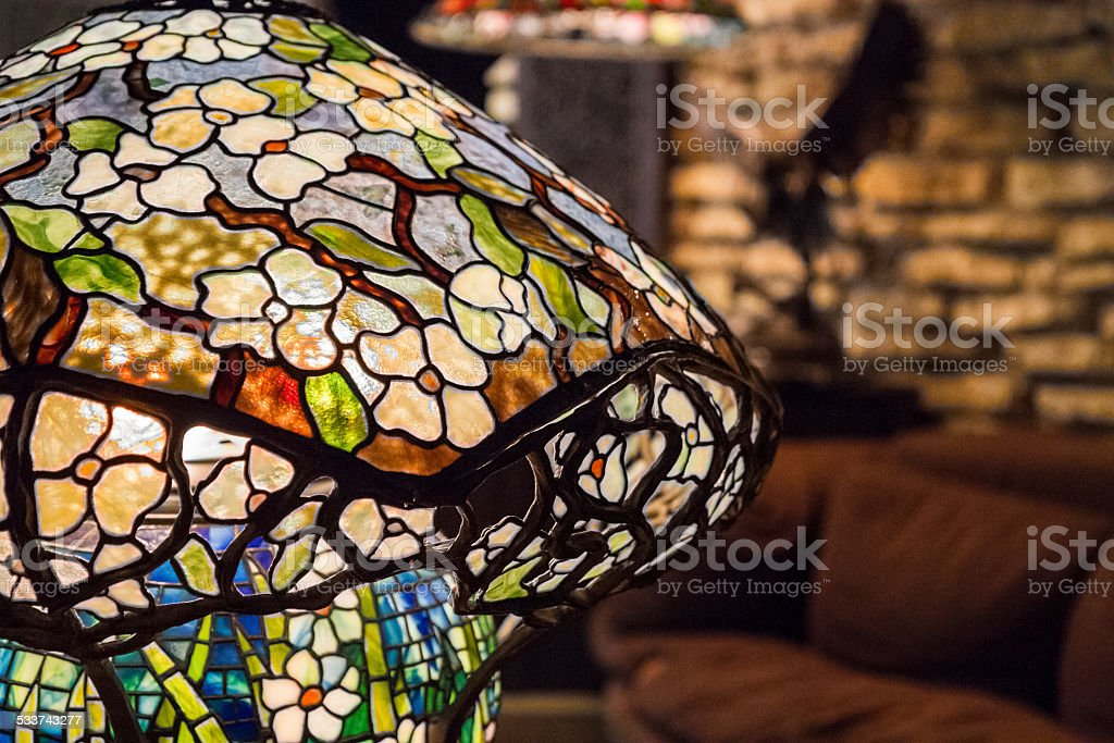 Detail of lit Tiffany-style stained leaded glass lamp stock photo