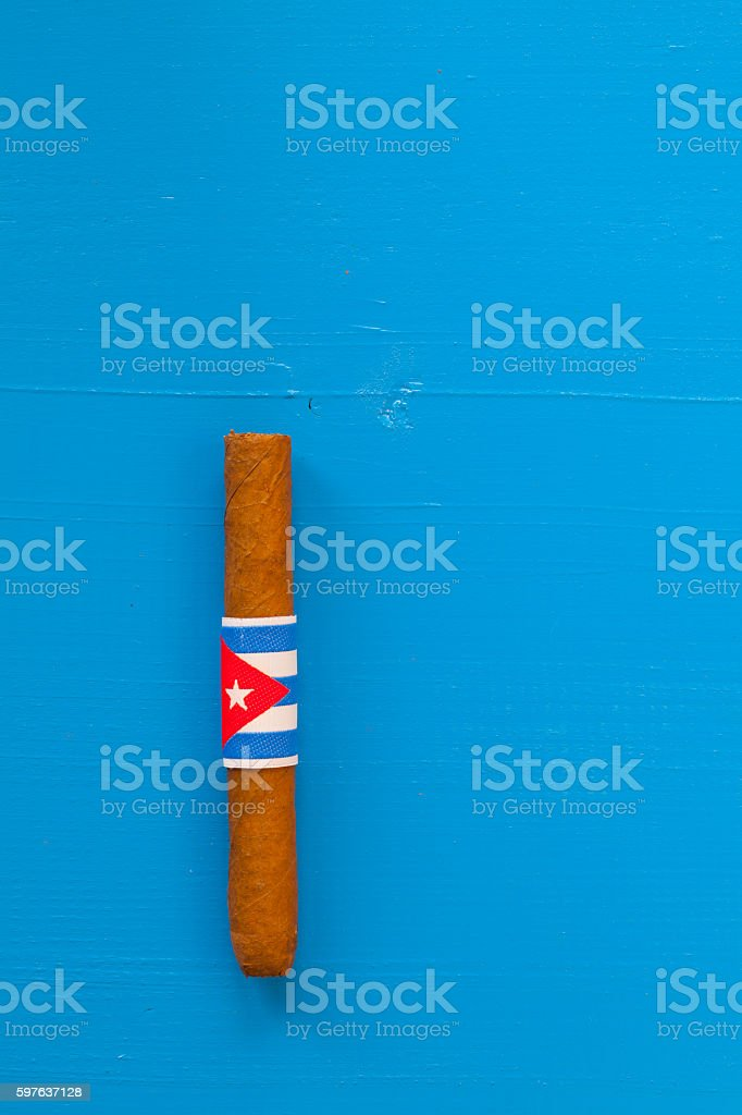 Detail of luxury Cuban cigars on the blue table stock photo