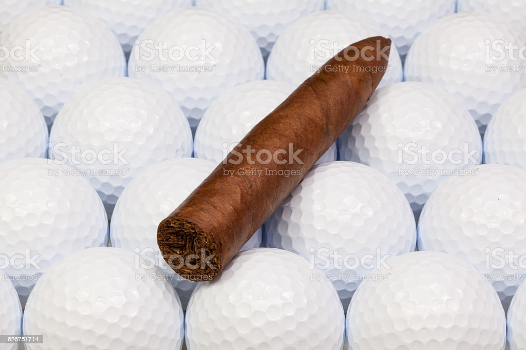 Detail of luxury Cuban cigars on the  golf balls stock photo