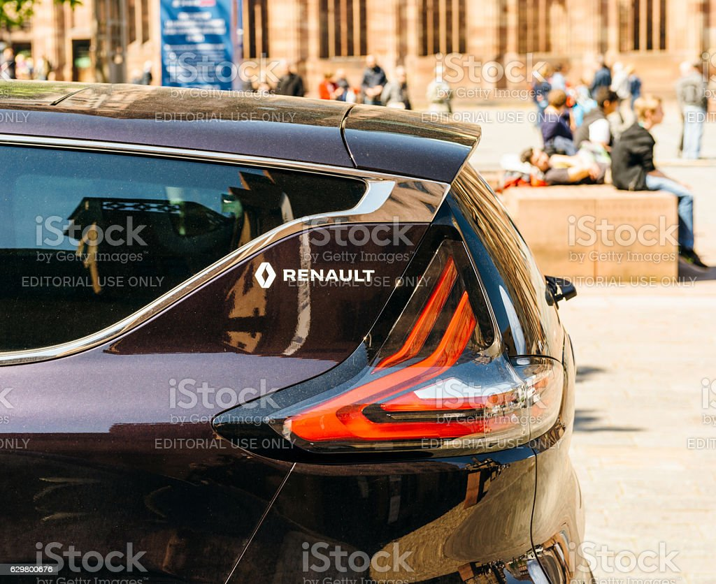 Detail of luxury Renault Initiale Paris in city background stock photo