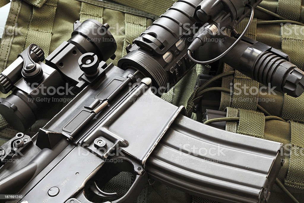 Detail of M4A1 (AR-15) carbine and tactical vest stock photo