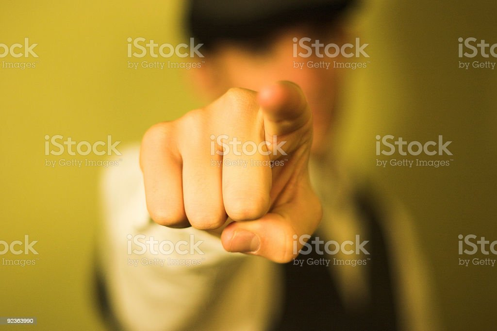 Detail of man pointing index finger on yellow background  stock photo