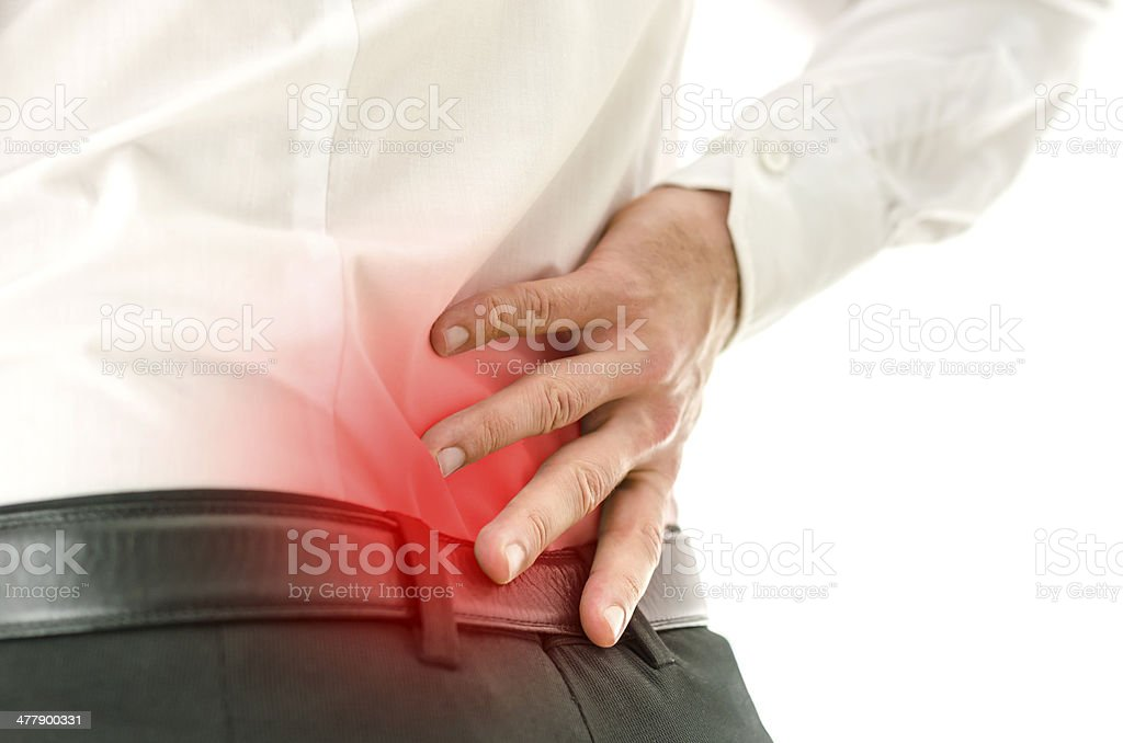 Detail of man suffering from back pain stock photo
