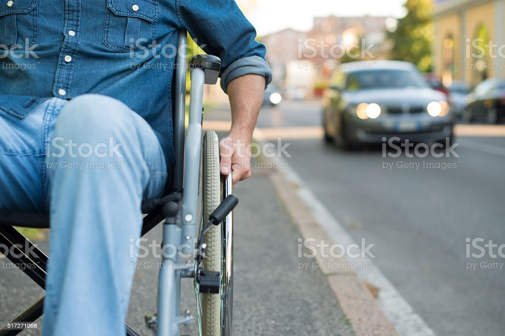 Detail of man using a wheelchair stock photo