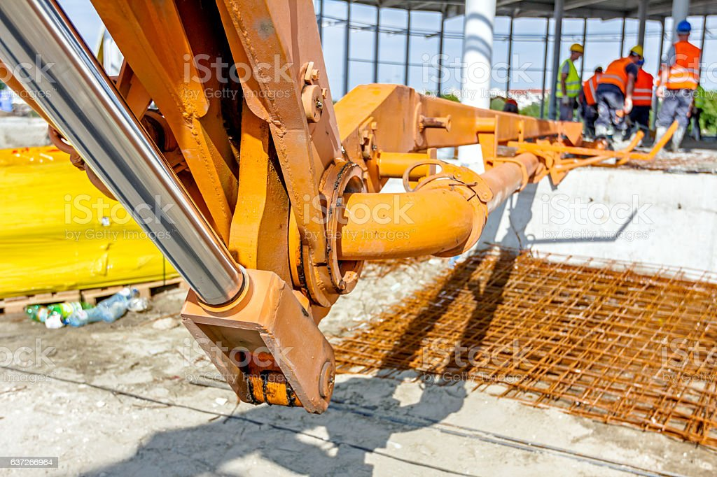 Detail of mechanical joint at crane's arm. Concrete transport. stock photo