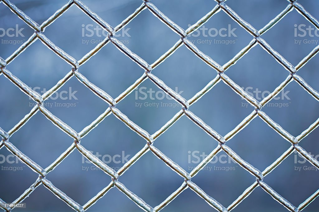 Detail of metal fence covered by ice stock photo