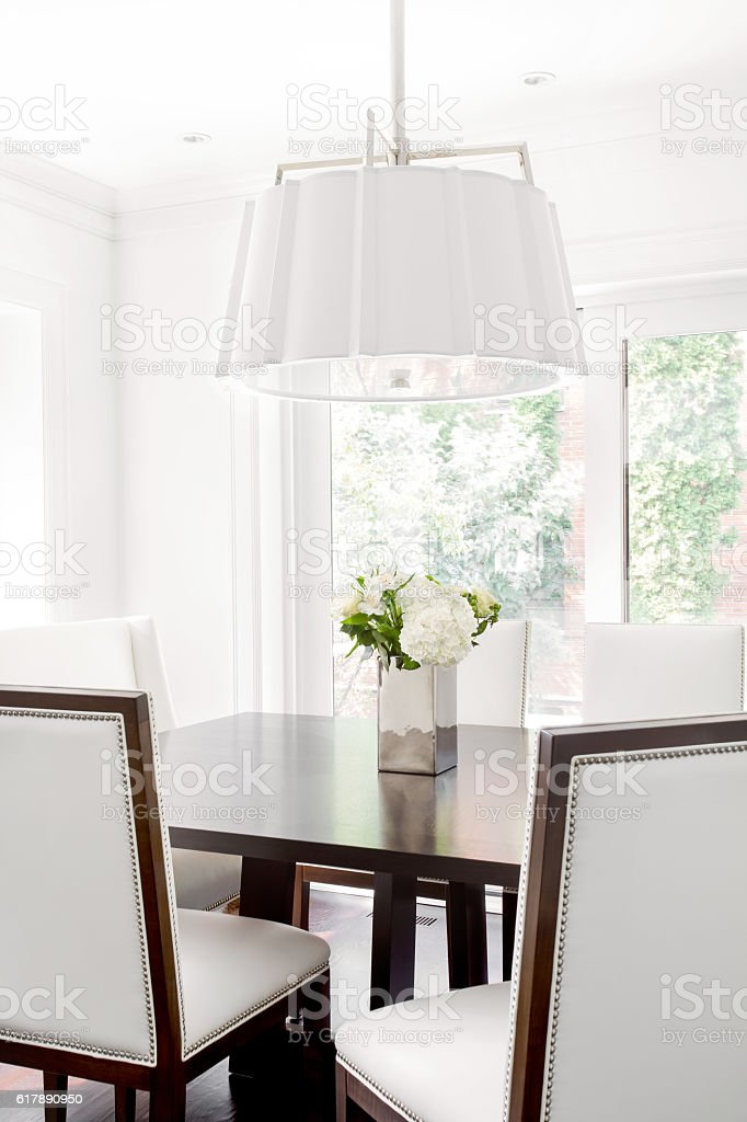 Detail of Modern Dinning room set with modern white chandelier stock photo