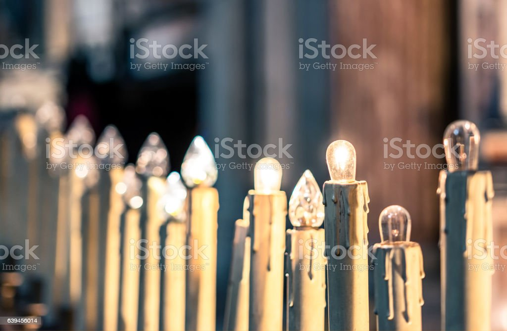 detail of modern electric candles in church stock photo