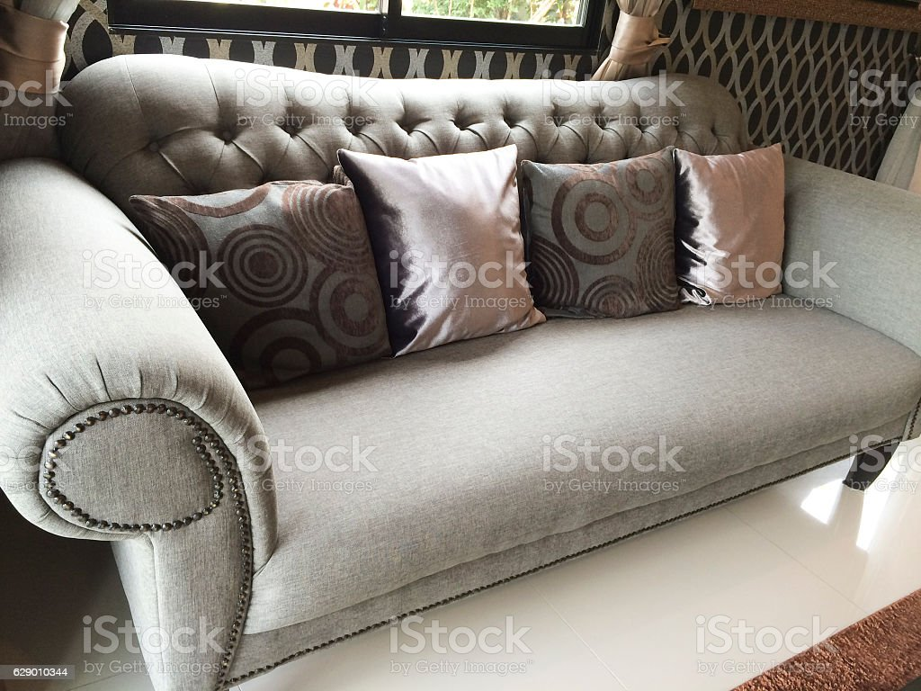 Detail of modern living room with  pillow cushions on sofa stock photo
