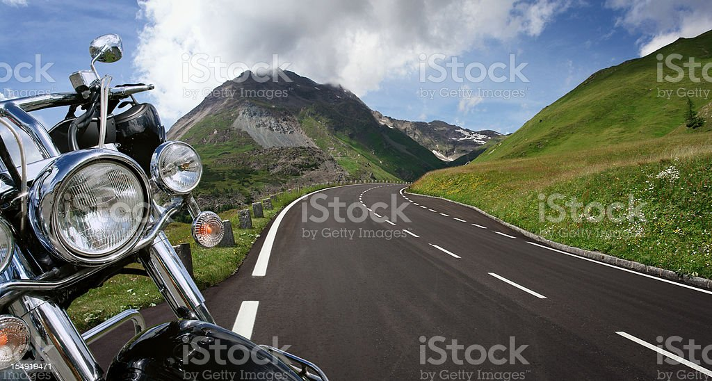 Detail of Motorbike next to the Road royalty-free stock photo