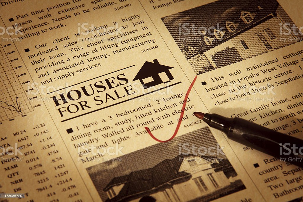 Detail of Newspaper with Houses for Sale Ads stock photo