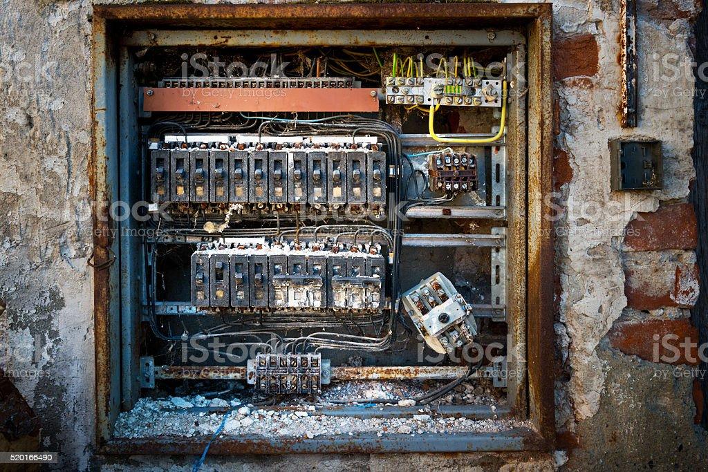detail of old broken circuit breakers stock photo