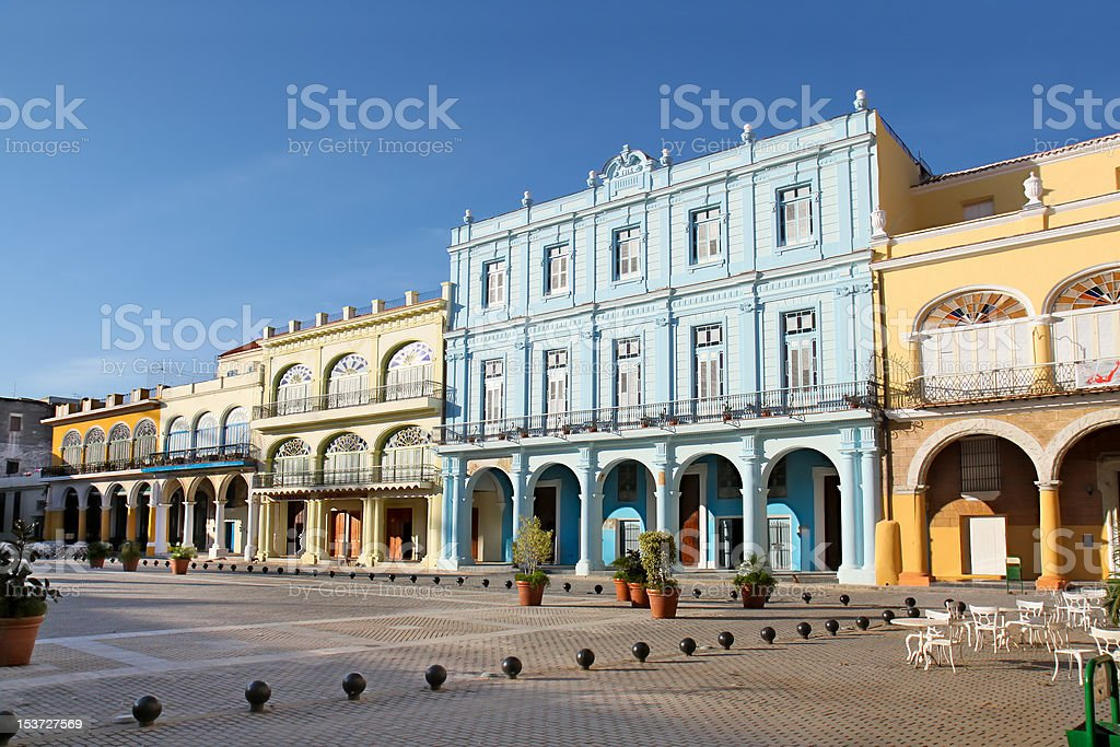 Detail of Old Havana plaza Vieja with colorful tropical buildings stock photo