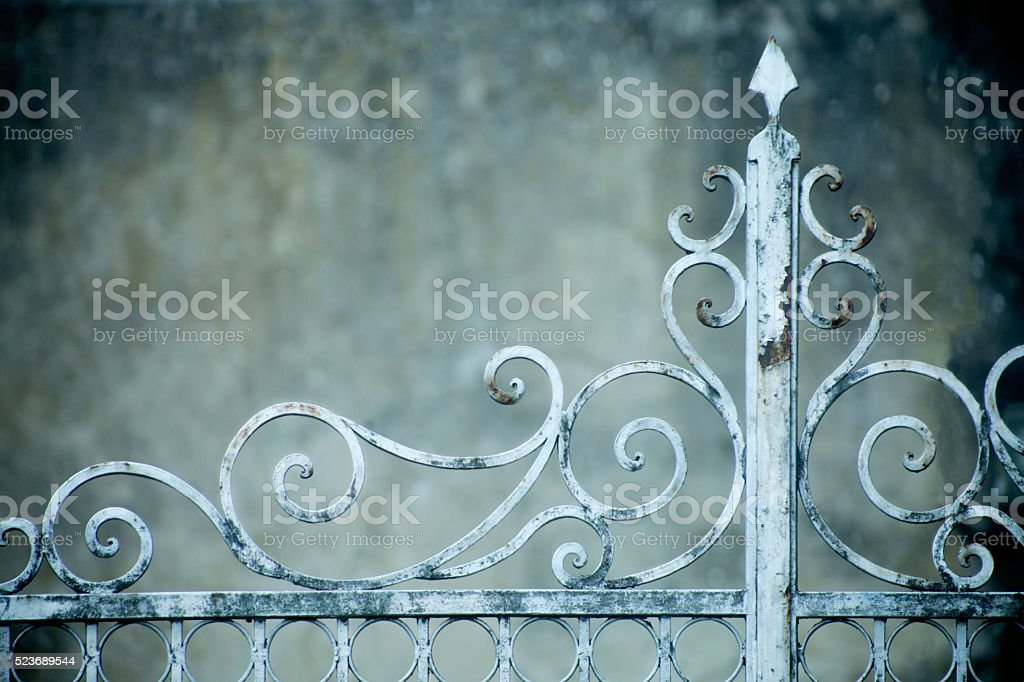 Detail of old rusty cast iron gate. stock photo