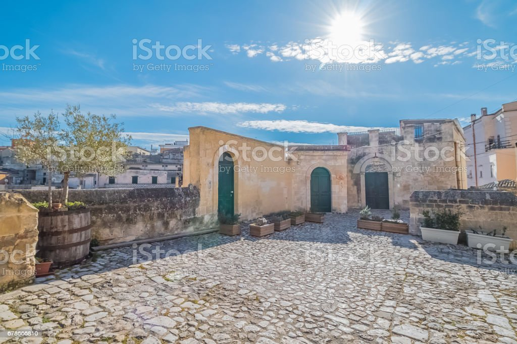 detail of panoramic view of typical stones (Sassi di Matera) and church of Matera stock photo