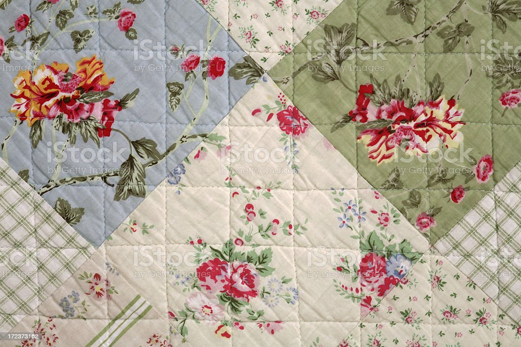 Detail of patchwork blanket decorated with pastel flowers, top view royalty-free stock photo