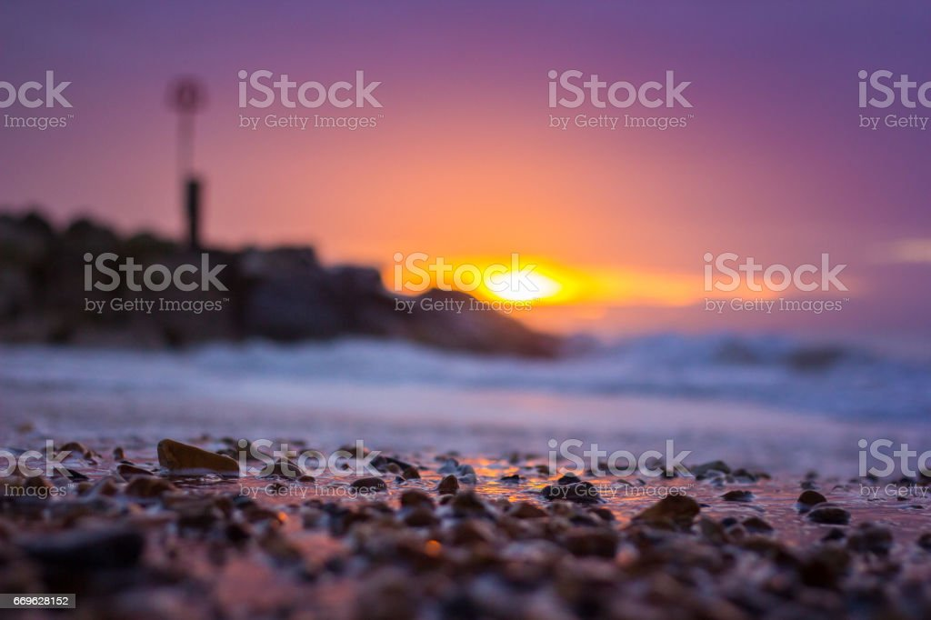 Detail of pebbles on Southbourne Beach at sunrise stock photo