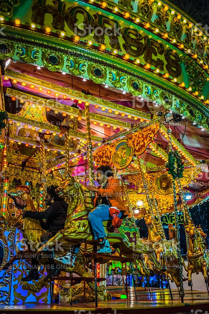 Detail of people riding the Christmas carousel in Leicester Square stock photo