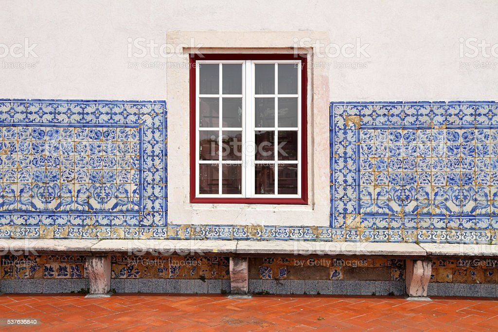 detail of Portuguese house-  window and tiled facde close-up stock photo