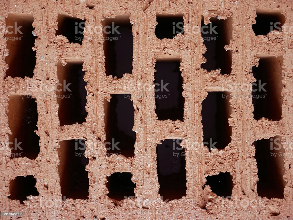 detail of red brick with holes stock photo