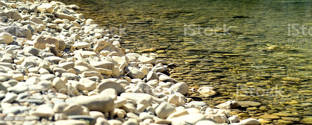 Detail of river-bed stones stock photo