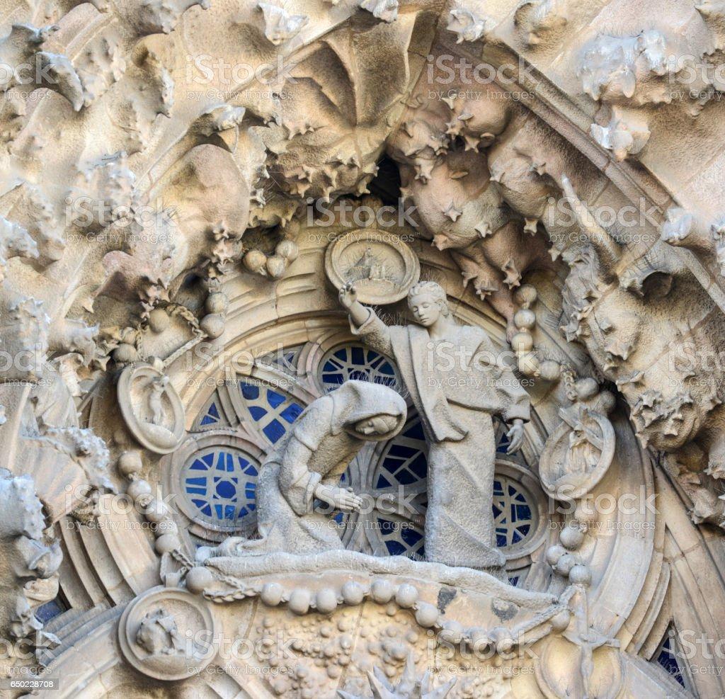 BARCELONA, SPAIN - DECEMBER 31, 2015: Detail of Sagrada Familia church (Temple Expiatori de la Sagrada Famalia) in Barcelona, Spain. Designed by Antoni Gaudi, UNESCO World Heritage Site stock photo