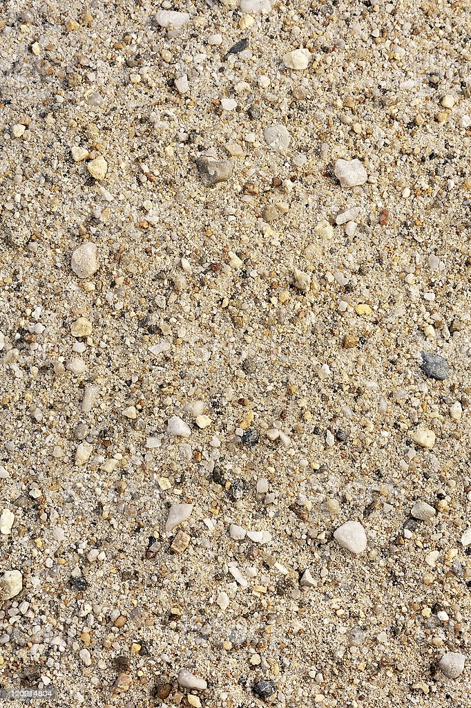 Detail of sand texture with small stones - background royalty-free stock photo