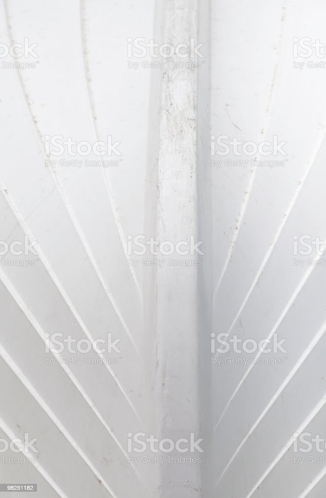 Detail of scraped synthetic boat hull royalty-free stock photo