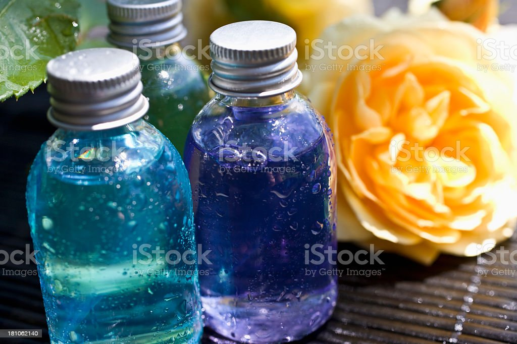 Detail of Spa oils and yellow rose royalty-free stock photo