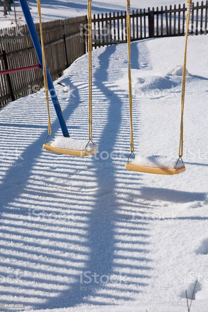 Detail of swing in Gstaad, Switzerland, in winter with snow stock photo