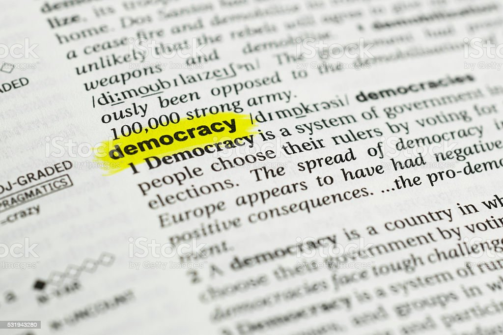 Detail of the english word 'democracy' and its meaning stock photo