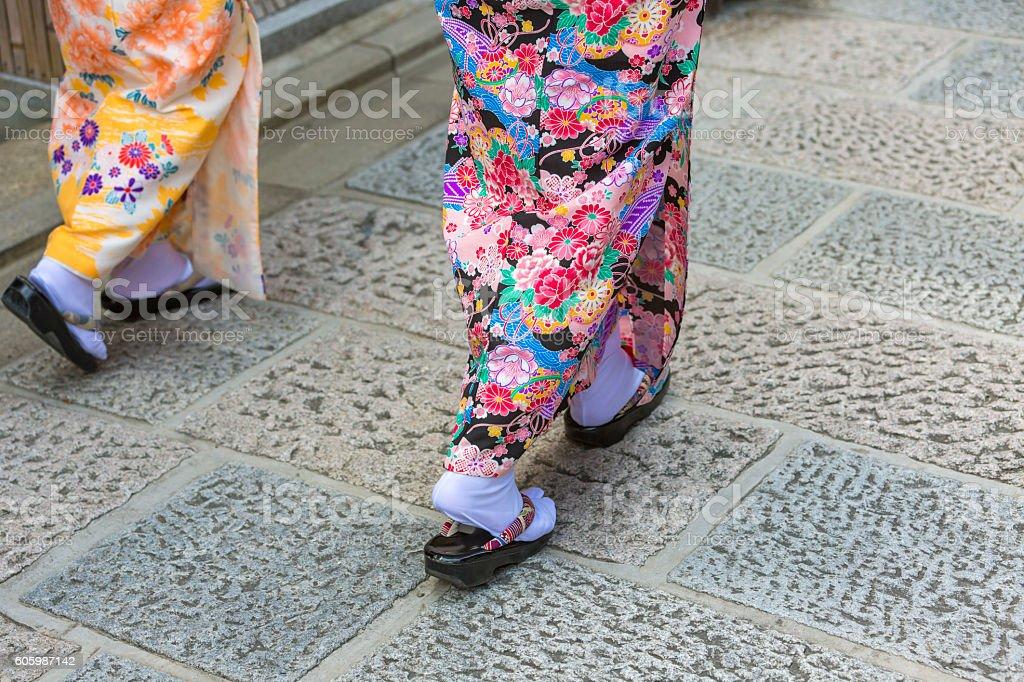 Detail of the Feet of Japanese Women Walking in Kimonos stock photo