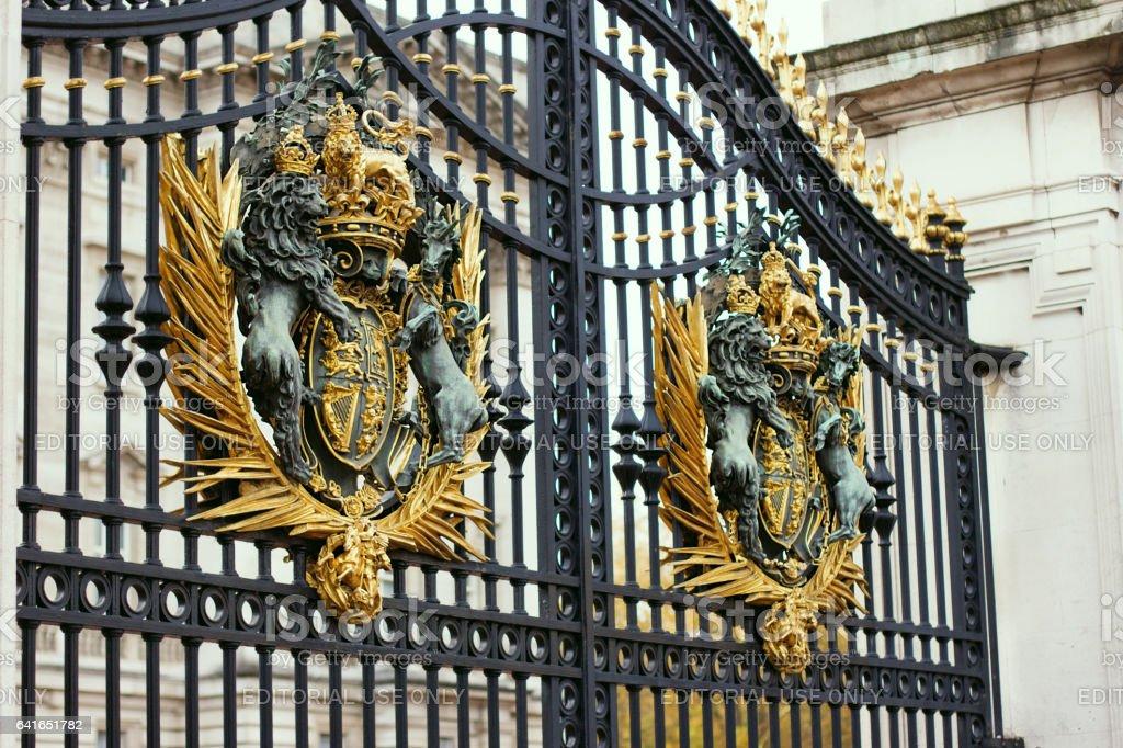 LONDON - NOVEMBER 16, 2016: Detail of the gates at the entrance gate of Buckinham Palace stock photo