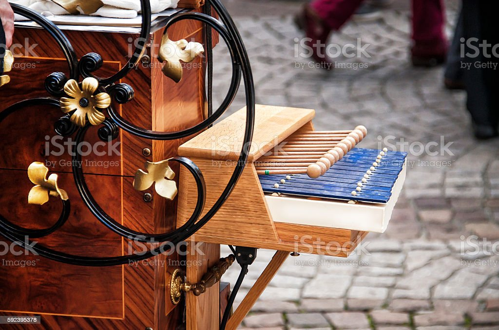 Detail of the hurdy-gurdy on street background stock photo
