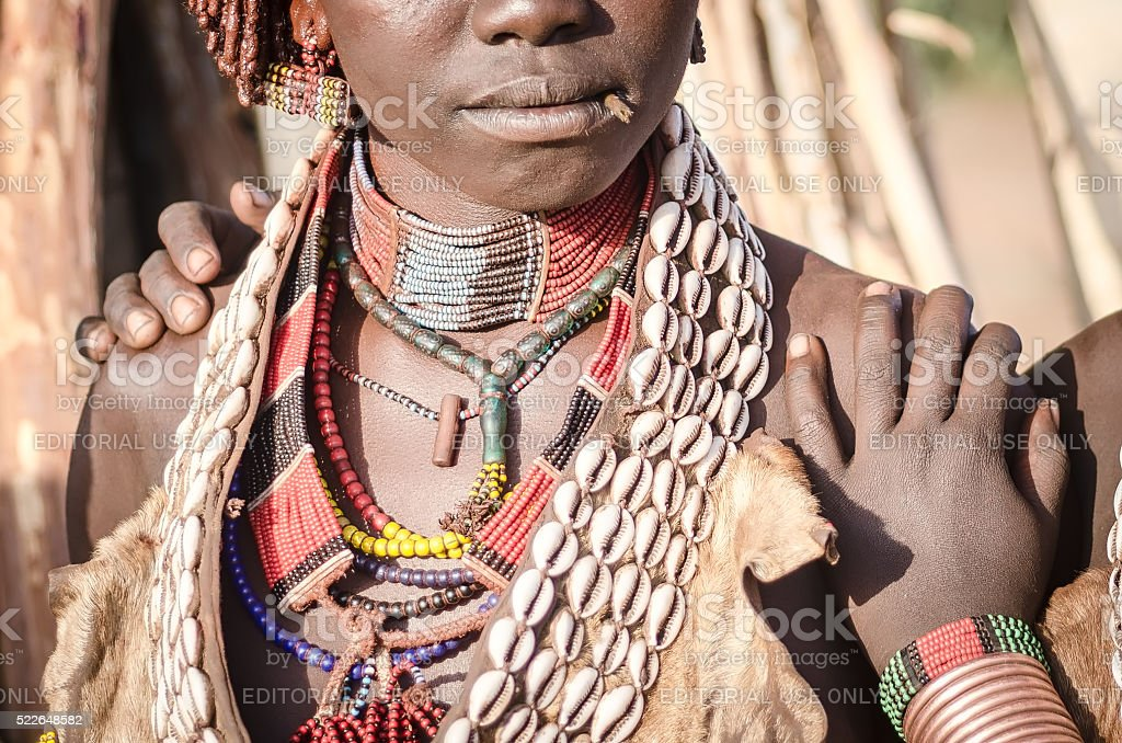 Detail of the jewelry of a Hamer woman stock photo