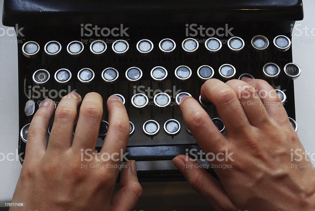Detail of the keyboard, typewriter with two hands royalty-free stock photo