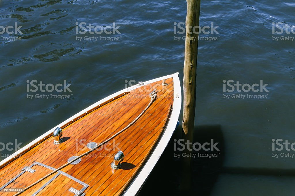 Detail of the wooden deck of a boat moored stock photo