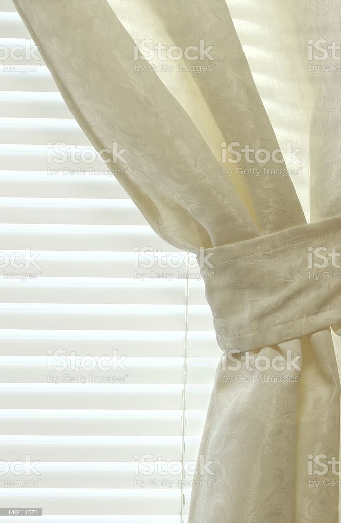 Detail of Tied-Back Curtain and Blinds royalty-free stock photo