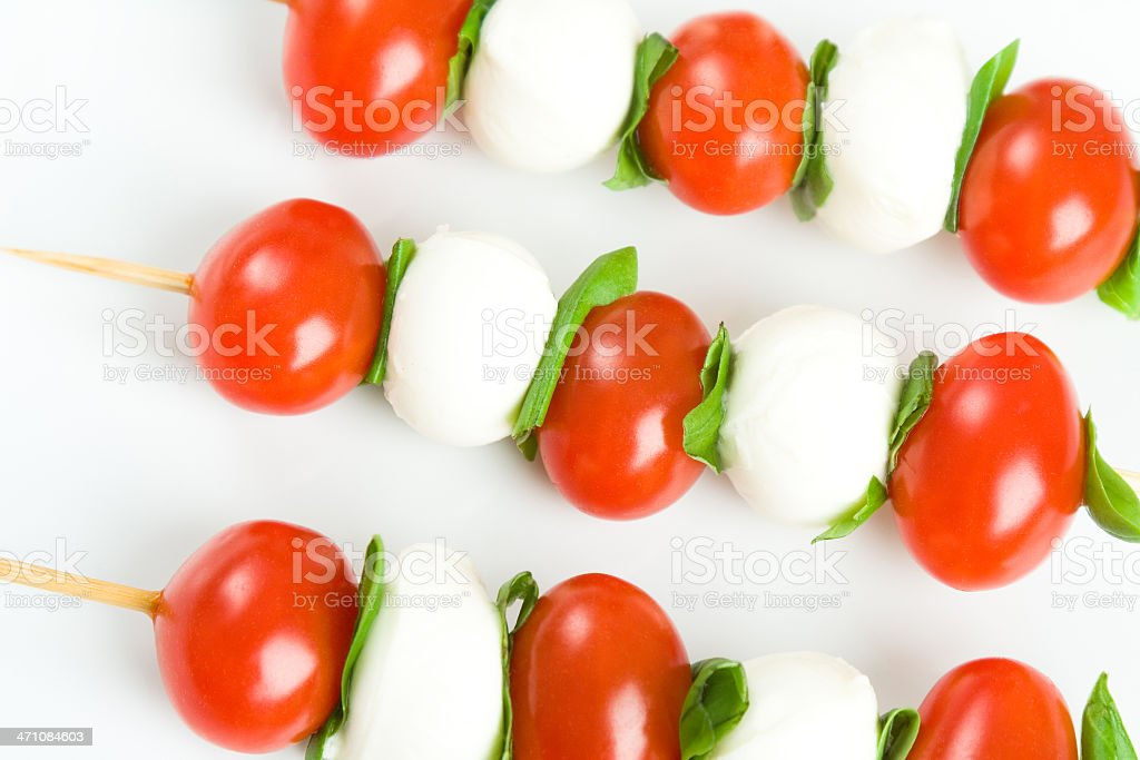 Detail of tomatoes and mozzarella skewers royalty-free stock photo